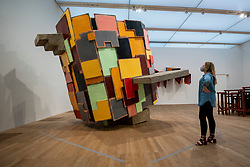 © Licensed to London News Pictures. 23/08/2021. LONDON, UK.  A staff member views an untitled work at the preview of ARTIST ROOMS: Phyllida Barlow, a new exhibition of work by British artist Phyllida Barlow which includes several large-scale installations and a selection of drawings across her sixty-year career.  Photo credit: Stephen Chung/LNP