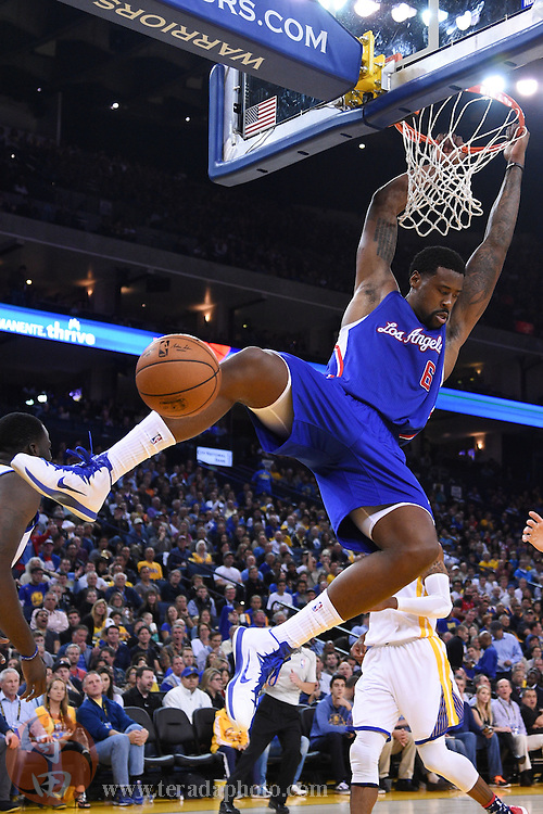November 5, 2014; Oakland, CA, USA; Los Angeles Clippers center DeAndre Jordan (6) dunks the basketball against the Golden State Warriors during the second quarter at Oracle Arena.