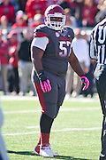 Oct 27, 2012; Little Rock, AR, USA; Arkansas Razorback defensive tackle Jared Green (57) stands on the field during a game against the Ole Miss Rebels at War Memorial Stadium. Ole Miss defeated Arkansas 30-27. Mandatory Credit: Beth Hall-US PRESSWIRE