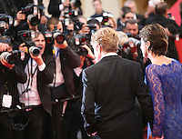 Robert Redford and Sibylle Szaggars face photographers at the All Is Lost film gala screening at the Cannes Film Festival Wednesday 22nd May 2013