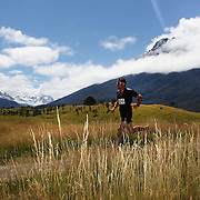 Simon Green in action during the run leg of the Paradise Triathlon and Duathlon series with breathtaking views of Mount Aspiring National Park, Paradise, Glenorchy, South Island, New Zealand. 18th February 2012. Photo Tim Clayton