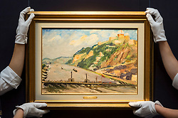 "© Licensed to London News Pictures. 16/11/2018. LONDON, UK. Technicians present ""On The Rhine"" by Sir Winston Churchill (Est. GBP70,000-100,000). Preview of Sotheby's autumn sale of Modern & Post War British art.  Works from the British art scene of the past century will be offered for sale on 20 and 21 November 2018 at Sotheby's in London.  Photo credit: Stephen Chung/LNP"