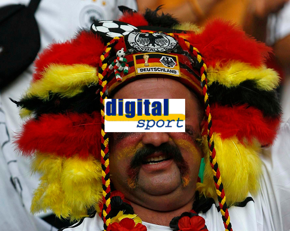 Photo: Glyn Thomas.<br /> Germany v Sweden. Second Round, FIFA World Cup 2006. 24/06/2006.<br /> <br /> A Germany fan celebrates.
