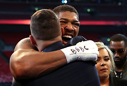 Anthony Joshua post fight boxer Tony Bellow following the IBF, WBA and IBO Heavyweight World Title bout at Wembley Stadium, London.