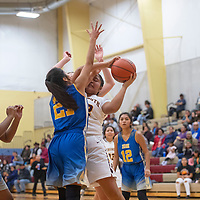 Rehoboth Christian's Ashley Skeets (42) tries to take a shot as Zuni's Alexia Bobelu (21) defends Friday night at Rehoboth Christian School in Rehoboth.
