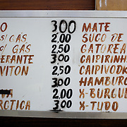 A food and drinks menu at a kiosk on Copacabana beach, Rio de Janeiro,  Brazil. 16th July 2010. Photo Tim Clayton..