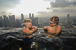 Teenage boys in an infinity pool, Marina Bay Sands, Singapore City, Singapore