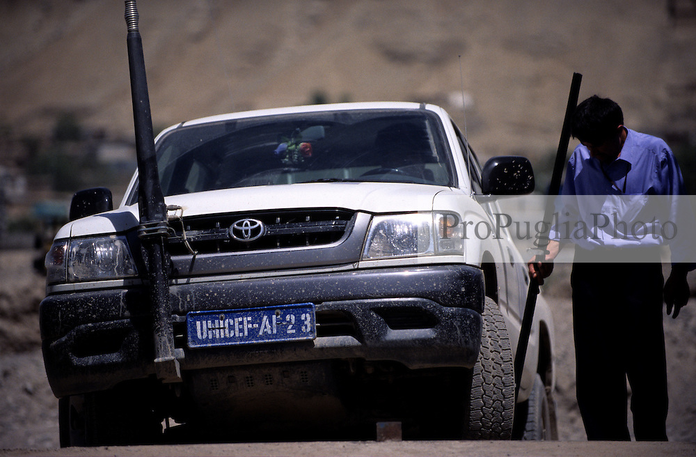 UNFPA COMPOUND, 27 July 2005..A security guard checks the UN white vehicle for IED/mines...