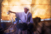 Berber nomad camel guide El-Hussein Sbiti pours cups of mint tea in a tent during a trip to the Erg Zehar dunes, outside M'Hamid, Morocco. Sbiti, like many berber nomads in the region, has found opportunity in the new tourism trade burgeoning since the settling of tensions between Morocco and neighboring Algeria.