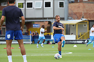 AFC Wimbledon striker James Hanson (18) passing the ball to AFC Wimbledon defender Will Nightingale (5) during the EFL Sky Bet League 1 match between AFC Wimbledon and Coventry City at the Cherry Red Records Stadium, Kingston, England on 11 August 2018.