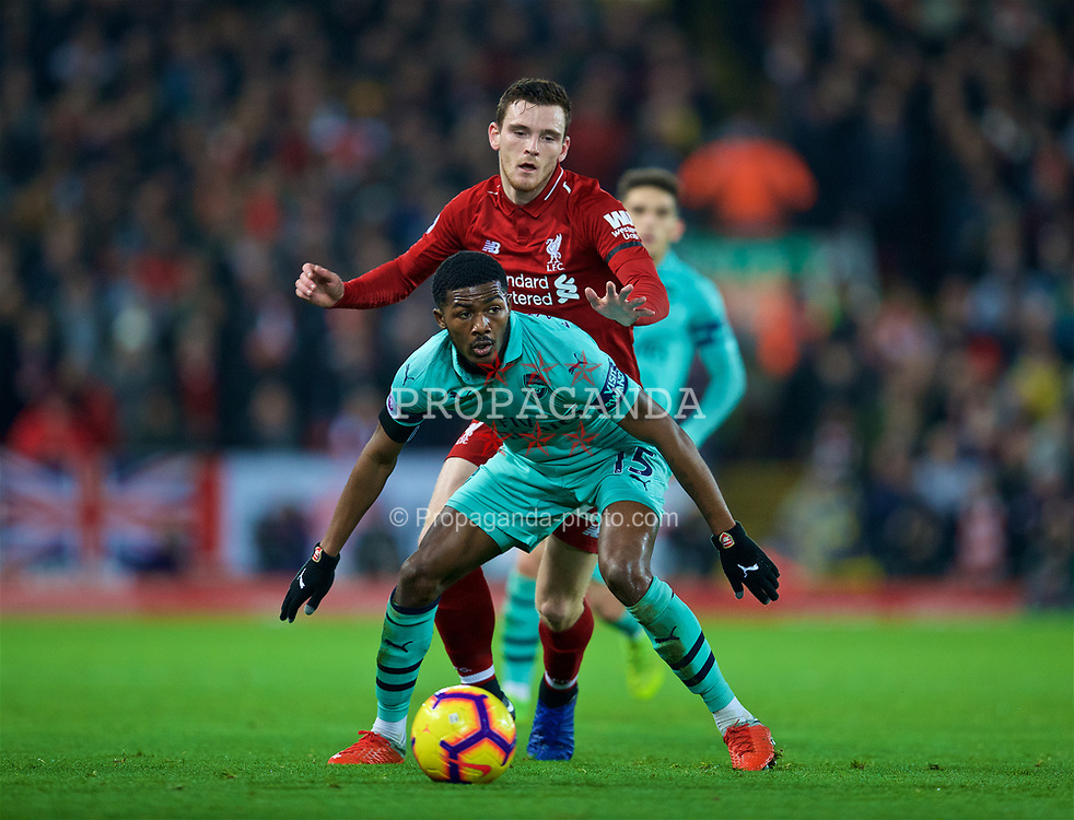 LIVERPOOL, ENGLAND - Saturday, December 29, 2018: Arsenal's Ainsley Maitland-Niles and Liverpool's Andy Robertson during the FA Premier League match between Liverpool FC and Arsenal FC at Anfield. (Pic by David Rawcliffe/Propaganda)