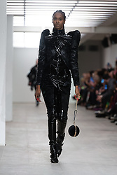 © Licensed to London News Pictures. 14/02/2020. London, UK.  London Fashion Week Autumn Winter 2020 On Off Presents... Yan Dengyu runway show - model on the catwalk.  Photo credit : Richard Isaac/LNP