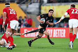 Anton Leinert-Brown - New Zealand centre gets his shorts pulled down by the despairing tackle of Wales full back Hallam Amos.<br /> New Zealand v Wales, Rugby World Cup, Bronze Final, Tokyo Stadium, Tokyo, Japan, Saturday 1st November 2019. ***Please credit: Fotosport/David Gibson***