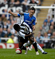Photo: Jed Wee/Sportsbeat Images.<br /> Newcastle United v Chelsea. The Barclays Premiership. 22/04/2007.<br /> <br /> Newcastle's Obafemi Martins (L) tries to get away from the attentions of Chelsea's Frank Lampard.