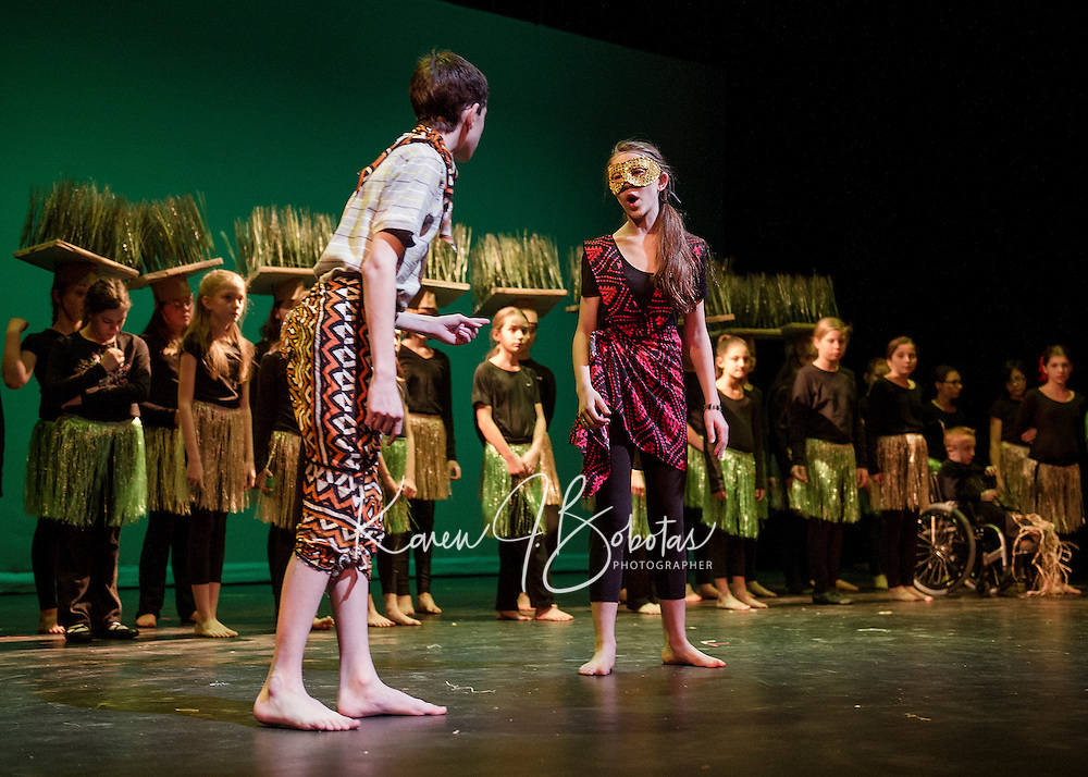 """Simba (Taylor Browne) and Nala (Mae Kenney find each other in the grasslands during Monday afternoon dress rehearsal for """"The Lion King"""" production with the Gilford Middle School.  (Karen Bobotas/for the Laconia Daily Sun)"""