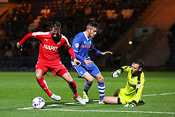 Sam Hird of Chesterfield clears the ball away from Matthew Lund of Rochdale  - Mandatory byline: Matt McNulty/JMP - 07966 386802 - 06/10/2015 - FOOTBALL - Spotland Stadium - Rochdale, England - Rochdale v Chesterfield - Johnstones Paint Trophy