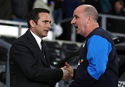 Derby County manager Frank Lampard and Wigan Athletic manager Paul Cook during the Sky Bet Championship match at Pride Park, Derby.