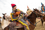 Costumed revelers ride horses during the Mamou Courir de Mardi Gras chicken run on Fat Tuesday February 17, 2015 in Mamou, Louisiana. The traditional Cajun Mardi Gras involves costumed revelers competing to catch a live chicken as they move from house to house throughout the rural community.