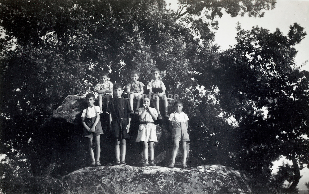 youth posing on a rock France 1937