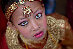 Young Nepalese girls dressed as kumaris – or living goddesses – participate in Kumari Puja, an event where hundreds of girls come to be worshiped at a single ceremony. Participation is believed to help protect them from evil and give them good luck for years to come.