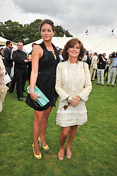 Left to right, SASKIA BOXFORD and her mother PILAR BOXFORD at the 25th annual Cartier International Polo held at Guards Polo Club, Great Windsor Park, Berkshire on 26th July 2009.