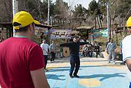 Tehran. Iran men play zurkanek in Ab-o-Atash Park