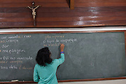 A teacher leads a portuguese language lesson which is supported and funded by CAMI, an organistation that supports migrants in  São Paulo, Brazil.<br /> <br /> Each year, CAMI helps over 5,700 people to be legalised in the country. Their courses are attended by 500-700 people annually, while 12,000-14,000 immigrants take part in their events. They also distribute over 60,000 newspapers in the city.