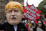 Boris Johnson caricature with a No-Deal Time Bomb protest in Westminster on the day that Parliament reconvenes after summer recess to debate and vote on a bill to prevent the UK leaving the EU without a deal at the end of October, on 3rd September 2019 in London, England, United Kingdom. Today Prime Minister Boris Johnson will face a showdown after he threatened rebel Conservative MPs who vote against him with deselection, and vowed to aim for a snap general election if MPs succeed in a bid to take control of parliamentary proceedings to allow them to discuss legislation to block a no-deal Brexit.