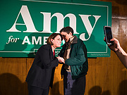 26 JANUARY 2020 - AMES, IOWA: US Senator AMY KLOBUCHAR (D-MN) talks to a woman in the selfie line after a campaign speech at an event in Ames.  Sen. Klobuchar campaigned to support her candidacy for the US Presidency Sunday in central Iowa during the one day break from the impeachment trial of President Trump. She is trying to capitalize on her recent uptick in national polls. Iowa holds the first selection event of the presidential election cycle. The Iowa Caucuses are Feb. 3, 2020.     PHOTO BY JACK KURTZ