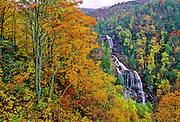 Fall color surrounds Whitewater Falls in North Carolina. The falls are the highest falls east of the Mississippi River.