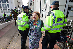 © Licensed to London News Pictures. 02/06/2012. Brighton, UK. Police detain a woman opposed to the EDL and other nationalist groups in Brighton. Photo credit : Joel Goodman/LNP