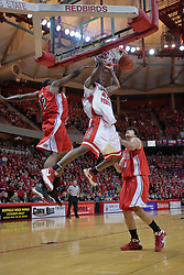 """31 January 2009: Dinma Odiakosa gets past Theron Wilson and Sam Singh for a slam. The Illinois State University Redbirds join the Bradley Braves in a tie for 2nd place in """"The Valley"""" with a 69-65 win on Doug Collins Court inside Redbird Arena on the campus of Illinois State University in Normal Illinois"""