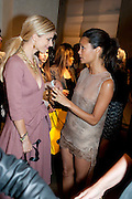LAURA BAILEY; THANDIE NEWTON, Vogue: Fashion's Night Out: Armani. Bond st.  London. 8 September 2010.  -DO NOT ARCHIVE-© Copyright Photograph by Dafydd Jones. 248 Clapham Rd. London SW9 0PZ. Tel 0207 820 0771. www.dafjones.com.