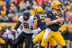 Nov 23, 2019; Morgantown, WV, USA; Oklahoma State Cowboys defensive end Mike Scott (91) rushes West Virginia Mountaineers quarterback Jarret Doege (2) during the third quarter at Mountaineer Field at Milan Puskar Stadium. Mandatory Credit: Ben Queen-USA TODAY Sports