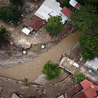 The main road through El Calan was destroyed when flood waters from hurricane Eta and Iota washed away the bridge over the waterway called Quebrada El Calan.