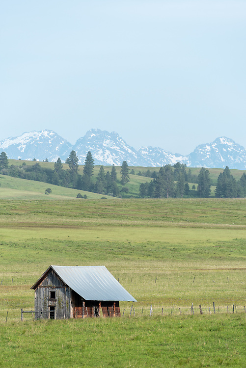 Ranch in Northeast Oregon with Idaho's Seven Devils Mountains in the background.