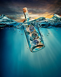 Maritime sailing-inspired watches in the bottle floating in the sea. Watches: Louis Vuitton's Tambour Regatta Navy, TAG Heuer Aquaracer Automatic Chronograph, IWC Portugieser Yacht Club Worldtimer