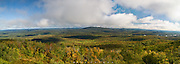 View From Mt Arab, Adirondacks, NY.  Big billowing clouds were heading my way, seemingly straight at me as I stood looking from the fire tower on Mt Arab.  Autumn was underway, though still early, and far out on the landscape the waters of the Raquette River glistened under the sun.