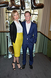 GUY & LIZZY PELLY at the 3rd birthday party for Spectator Life magazine hosted by Andrew Neil and Olivia Cole held at the Belgraves Hotel, 20 Chesham Place, London on 31st March 2015.