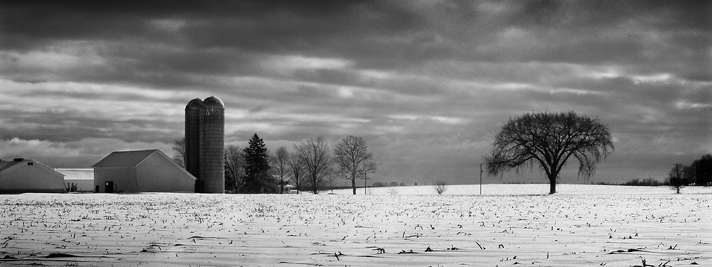 Winter has a way of making farms look barren and isolated.