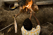 A worker tends the fire that will melt the wax for casting in the pit at the workshop in Swamimalai, India.The current Stpathy family is the twenty third generation of bronze casters dating back to the founding of the Chola Empire. The Stapathys had been sculptors of stone idols at the time of Rajaraja 1 (AD985-1014) but were called to Tanjore to learn bronze casting. Their methods using the ,ƒÚlost wax,ƒÙ process remains unchanged to this day..