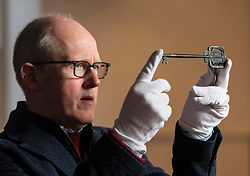 Lyon & Turnbull are auctioning the key used to open the Glasgow School of Art in 1899. The key, which will be sold on April 11, has not been seen in public since the school's opening ceremony.<br /> <br /> Pictured: John Mackie, Specialist at Lyon &Turnbull holding the Glasgow School of Art key