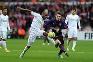 Swansea's Dwight Tiendalli (l) battles for the ball with Arsenal's Aaron Ramsey.  FA cup with Budweiser, 3rd round match, Swansea city v Arsenal at the Liberty Stadium in Swansea, South Wales on Sunday  6th Jan 2013. pic by Andrew Orchard, Andrew Orchard sports photography,