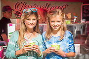 Two young girls enjoying Clover Leaf Creamery ice cream from Buhl while at the Thousand Springs Art Festival, Ritter Island, in Hagerman, Idaho. MR
