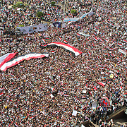 Only the exit to the Metro can be seen amid the sea of protesters in Cairo's Tahrir Square during the Day of Justice and Cleansing.