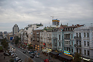Dusk descends on an overcast day on traffic and architecture in the center of Kiev, Ukraine.