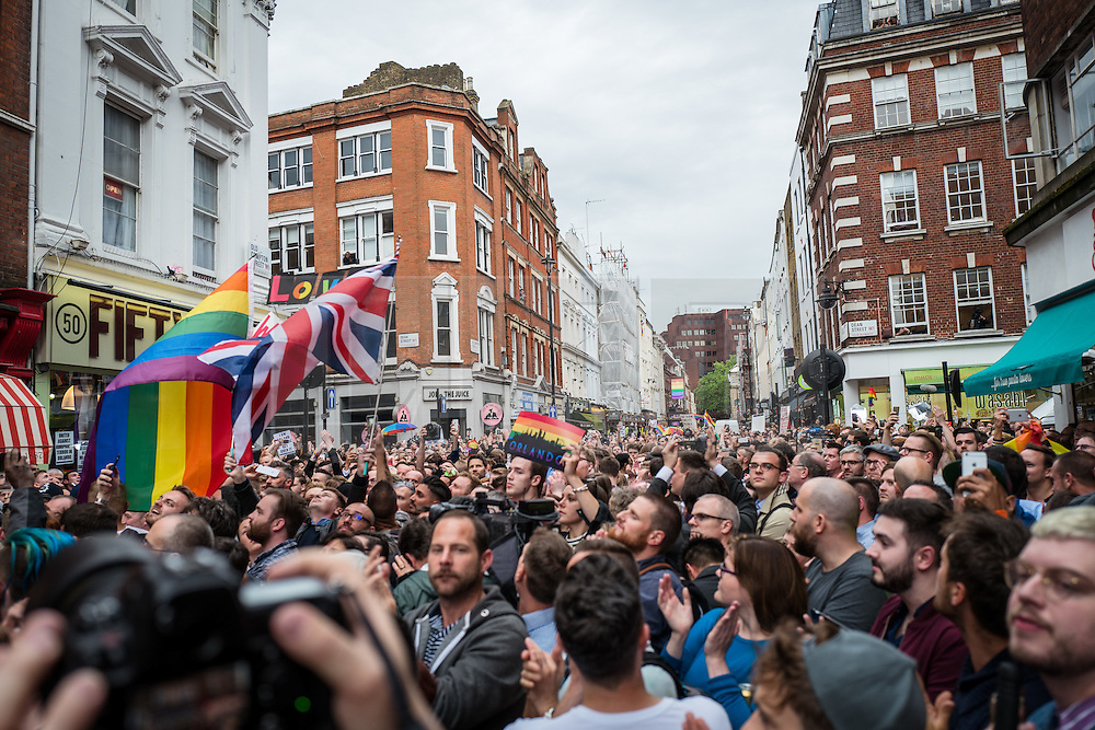 © Licensed to London News Pictures. 13/06/2016. London, UK. Thousands of Londoners gather on Old Compton Street in Soho for a vigil to pay tribute to the victims of the Pulse nightclub massacre in Orlando, Florida. In the early hours of 12 June 2016, 29-year-old Omar Mateen entered Pulse, a gay nightclub, and killed more than 50 people with an assault rifle, making it the deadliest mass shooting in US history. Photo credit: Rob Pinney/LNP