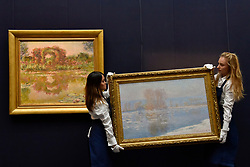 """© Licensed to London News Pictures. 06/10/2017. London, UK. (L to R) """"Les Arceaux De Roses, Giverny"""", 1913 and """"Les Glaçons, Bennecourt"""", 1893, both by Claude Monet at a preview at Sotheby's in New Bond Street of contemporary, impressionist and modern art works to be auctioned in New York in November 2017 Photo credit : Stephen Chung/LNP"""