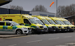 © Licensed to London News Pictures. 29/12/2020. Romford, UK. A row of ambulances are parked up at the A&E entrance to Queen's Hospital in Romford, eat London. A record of 41,385 cases of Covid-19 infections was reported on Monday and the number of people being treated for the virus in hospital has now reached 20,426, which is greater that the previous peak of about 19,000 in April. Photo credit: Peter Macdiarmid/LNP