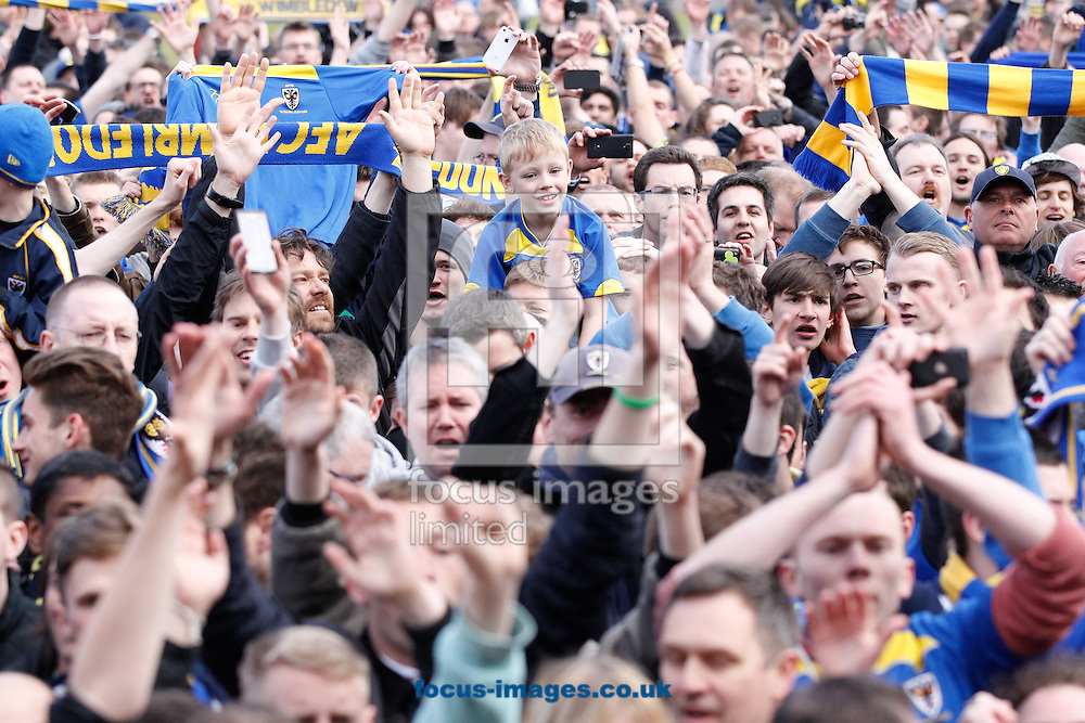 Picture by Andrew Tobin/Focus Images Ltd +44 7710 761829.27/04/2013. AFC Wimbledon fans celebrate after winning 2-1 and staying up during the npower League 2 match at the Cherry Red Records Stadium, Kingston.